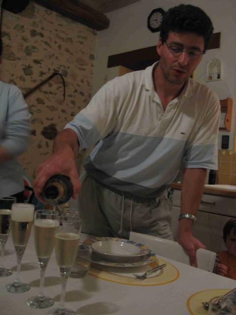 Laurent pours champagne